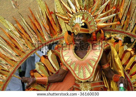 ST. JOHN, U.S. VIRGIN ISLANDS, JULY 9: A man in a colorful carnival costume in the St. John Carnival parade held July 9, 2009 in St. John, U.S. Virgin Island. - stock photo