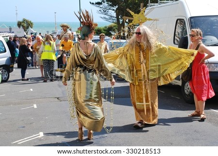 ST.LEONARDS-ON-SEA, ENGLAND - JULY 11, 2015: Costumed people take part in the parade at the annual St.Leonards Festival in Warrior Square. The free entertainment event was first held in 2006. - stock photo