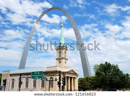 St. Louis Arch and the old Basilica Cathedral in St. Louis, Missouri - stock photo