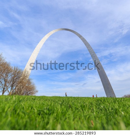 St. Louis Gateway Arch in Missouri with clouds and blue sky - stock photo