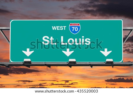 St Louis Interstate 70 west highway sign with sunrise sky. - stock photo