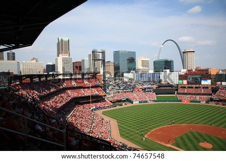 ST. LOUIS - SEPTEMBER 18: Skyline and Gateway Arch at Busch Stadium before a game between the Cardinals and Padres, with both teams fighting for the playoffs, on September 18, 2010 in St. Louis. - stock photo