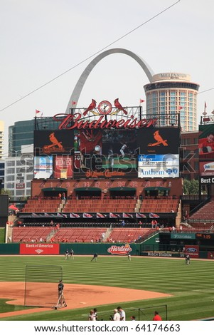 ST. LOUIS - SEPTEMBER 18: The Cardinals scoreboard and the Gateway Arch are seen from Busch Stadium before a game between the Cardinals and Padres, on September 18, 2010 in St. Louis. - stock photo