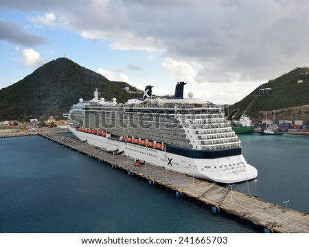 ST MAARTEN - DECEMBER 24: Celebrity Reflection arrives in the Caribbean island of of St Maarten on December 24, 2014. The island is a popular cruise destination in the Caribbean. - stock photo