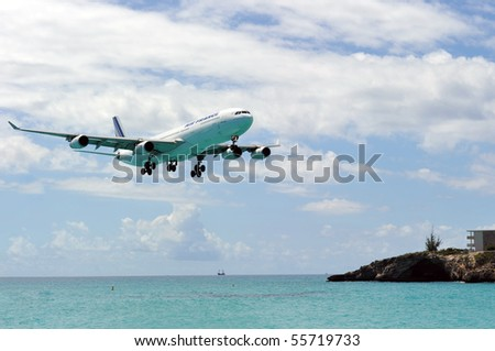 ST MARTIN, ANTILLES - APRIL 13: the tourist office and Air France signs an agreement to strengthen their partnership (joint communication plan). Daily A340 about to touch down in Apr. 2010 at SXM. - stock photo