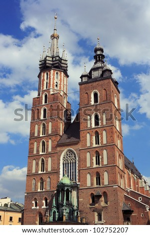 St. Mary's Basilica, a Gothic church re-built in the 14th century on the Main Market Square in Krakow, Poland. - stock photo