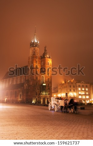St. Mary's Basilica on Market Square, Krakow - stock photo