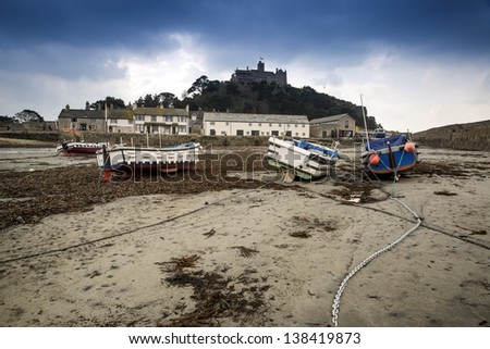 St Michael's Mount harbor Marazion landscape during stormy Spring morning Cornwall England - stock photo