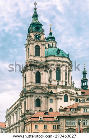 St. Nicholas Church, the baroque church on Lesser Town Square in Prague, Czech Republic. Toning in cool tones - stock photo