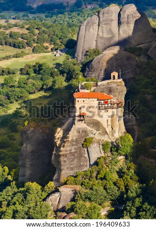 "St Nikolaos Anapafsas Monastery in Meteora rocks, meaning ""suspended into air"" in Trikala, Greece - stock photo"