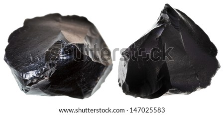 st of black obsidian stone isolated on white background - stock photo