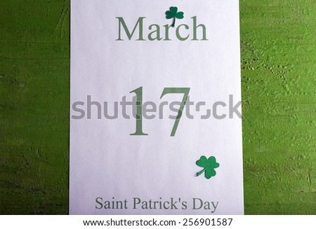 St. Patrick Date on calendar on wooden background - stock photo