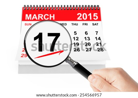 St. Patrick Day Concept. 17 march 2015 calendar with magnifier on a white background - stock photo