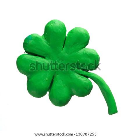 St Patrick holiday symbol - clover. Made of Plasticine - stock photo