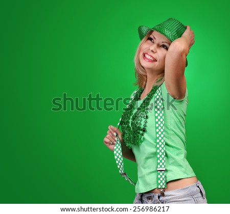 St Patrick's day Girl. Cheerful beautiful young woman with green hat  - stock photo