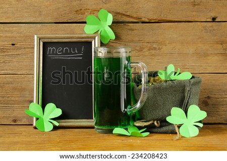 St Patrick's Day green beer with shamrock and   bag of gold coins - stock photo