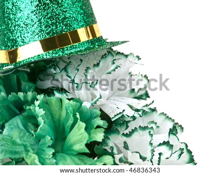 St. Patrick's Day inspired still-life of carnations topped with a glittering top hat on white - stock photo