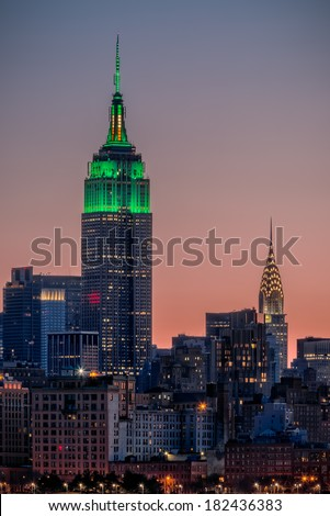 St Patrick's Day postcard. Empire State Building lit up in green for St Patrick's Day in New York City - stock photo
