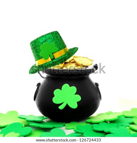 St Patrick's Day pot of gold with shamrocks and hat over white - stock photo