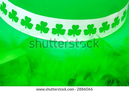 St. Patricks Day Hat and Boa (focus on clovers) - stock photo