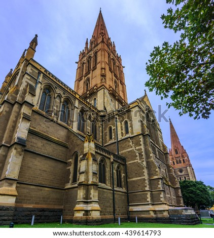 St Paul Cathedral at Flinders Street, Melbourne, Australia on April 13, 2015. The cathedral was built in stages and is one of the City of Melbourne's major landmarks. - stock photo