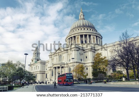 St. paul cathedral with red double decker bus in London, United Kingdom, vintage - stock photo