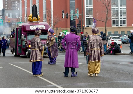 ST. PAUL, MINNESOTA - JANUARY 30, 2016: Euros Prince of East Winds and crew entertain crowd in St. Paul at Grande Day Parade on January 30 during Winter Carnival, an annual event dating back to 1886.  - stock photo