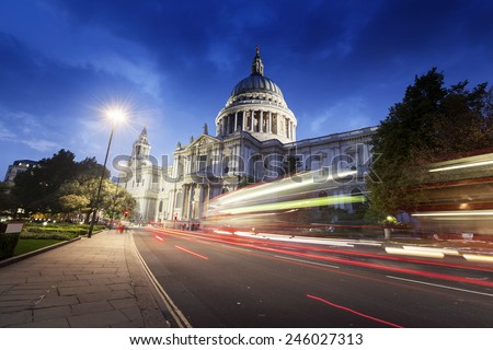 St Paul's Cathedral and moving Double Decker bus, London, UK - stock photo