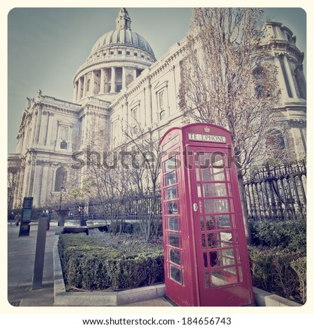 St. Paul's Cathedral and Red Telephone Box in London with Instagram effect filter - stock photo
