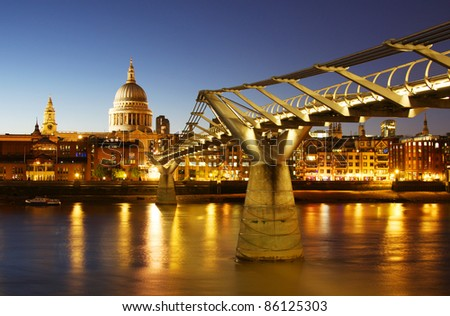 St. Paul's Cathedral and the Millennium Bridge in London - stock photo