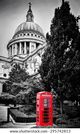 St Paul's Cathedral dome and red telephone booth. Symbols of London, the UK. Black and white - stock photo