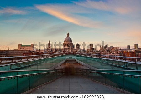 St Paul's Cathedral overlooks the River Thames and the Millennium Bridge. London, UK. - stock photo