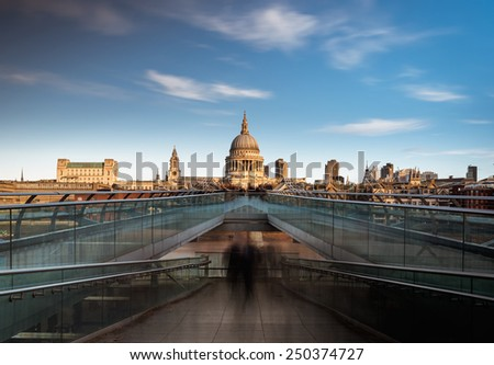 St Paul's Cathedral viewed from the Millennium bridge over river Thames, London, England. - stock photo