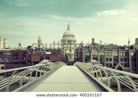 St Pauls Cathedral and Millennium Bridge in London. - stock photo