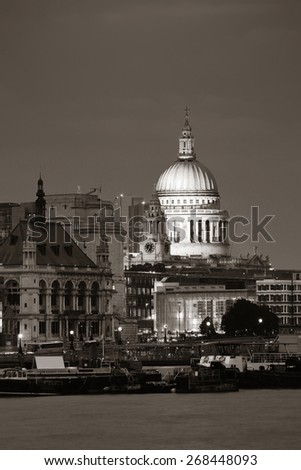 St Pauls Cathedral over Thames River at night in London in black and white. - stock photo