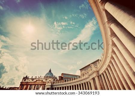 St. Peter's Basilica colonnades, columns in Vatican City. Vintage - stock photo