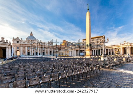 St. Peter's Square at the Vatican at sunset. St. Peter's Square at the Vatican at sunset on the eve of the Mass the Pope. - stock photo