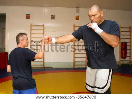 ST. PETERSBURG - AUGUST 14 : 2 times WBA Heavyweight Champion Nikolay Valuev (R) trains with coach Aleksandr Zimin August 14, 2007 in St. Petersburg, Russia. - stock photo