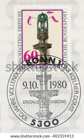 ST. PETERSBURG, RUSSIA - APR 7, 2016: A first day of issue postmark printed in Bonn, Germany, shows Setting Final Stone in South Tower, Cologne Cathedral, centure, circa 1980 - stock photo