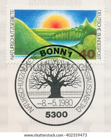 ST. PETERSBURG, RUSSIA - APR 7, 2016: A first day of issue postmark printed in Bonn, Germany, shows sunrise and tree, Nature Preserves, circa 1980 - stock photo