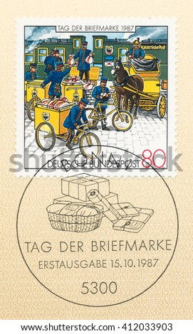ST. PETERSBURG, RUSSIA - APR 27, 2016: A first day of issue postmark printed in Germany, shows Postmen, circa 1987 - stock photo