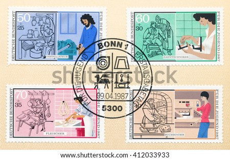 ST. PETERSBURG, RUSSIA - APR 27, 2016: A first day of issue postmark printed in Germany, shows old and new Plumber, Dental technician,  Butcher,  Bookbinder, circa 1987 - stock photo