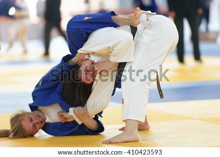 ST. PETERSBURG, RUSSIA - APRIL 16, 2016: Match Anna Dudenko (white) vs Elizaveta Stepanova, both of Russia, during the Junior European Judo Cup. 346 athletes participated in the competition - stock photo