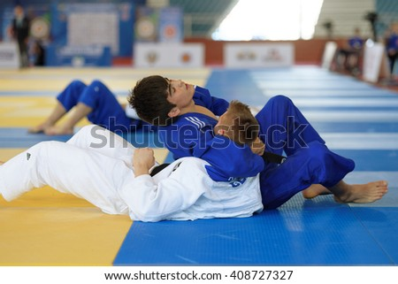 ST. PETERSBURG, RUSSIA - APRIL 16, 2016: Match Eradzh Abdulloev of Tajikistan (blue) vs Michel Adam of Germany during the Junior European Judo Cup. 346 athletes participated in the competition - stock photo