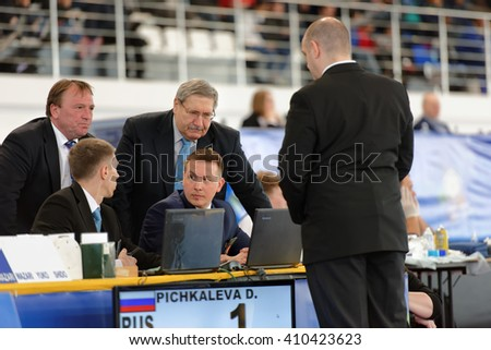 ST. PETERSBURG, RUSSIA - APRIL 16, 2016: Referees discuss the moment of the match Daria Pichkaleva of Russia vs Kim Akker of Netherlands. 346 athletes from 22 countries participated in the competition - stock photo