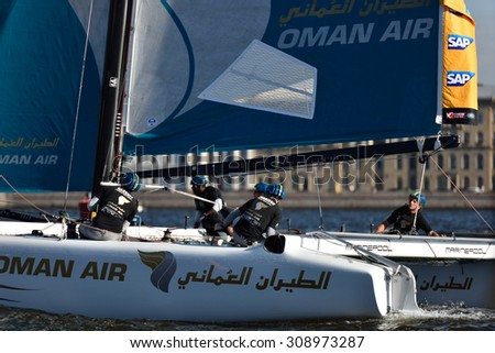 ST. PETERSBURG, RUSSIA - AUGUST 20, 2015: Catamaran of Oman Air sailing team during the 1st day of St. Petersburg stage of Extreme Sailing Series. Red Bull Sailing Team of Austria won the day - stock photo