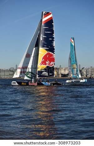 ST. PETERSBURG, RUSSIA - AUGUST 21, 2015: Extreme 40 catamarans during 2nd day of St. Petersburg stage of Extreme Sailing Series. Red Bull Sailing Team of Austria (center) leading after the 1st day - stock photo