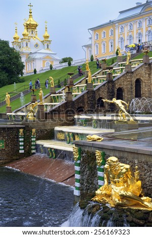ST. PETERSBURG, RUSSIA - August 14: gold plated sculptures by fountains Grand cascade in Peterhof, Saint Petersburg, Russia on August 14, 2014 - stock photo