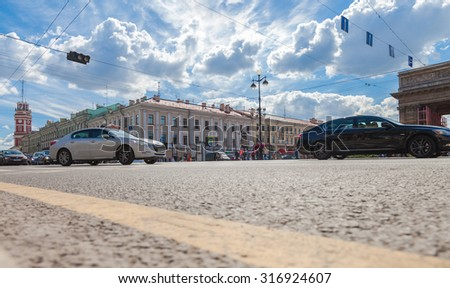 ST.PETERSBURG, RUSSIA - AUGUST 5, 2015: Road transport is moving along Nevsky Prospect in the summer sunny day - stock photo