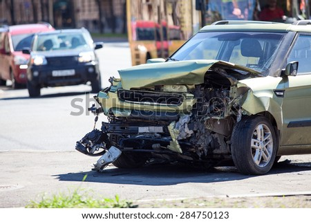 ST. PETERSBURG, RUSSIA - CIRCA MAY, 2015: Crashed car is on pavement after frontal collision. Accident with passing crossroads at a red light. Injured driver was hospitalized. - stock photo